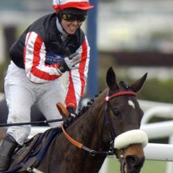 Liverpool, UNITED KINGDOM:  Graham Lee celebrates as he comes home to win the Grand National on Amberleigh House at Aintree racecourse in Liverpool, 03 April 2004. Amberleigh House won at 16-1 odds.    AFP PHOTO/PAUL BARKER  (Photo credit should read PAUL BARKER/AFP/Getty Images)
